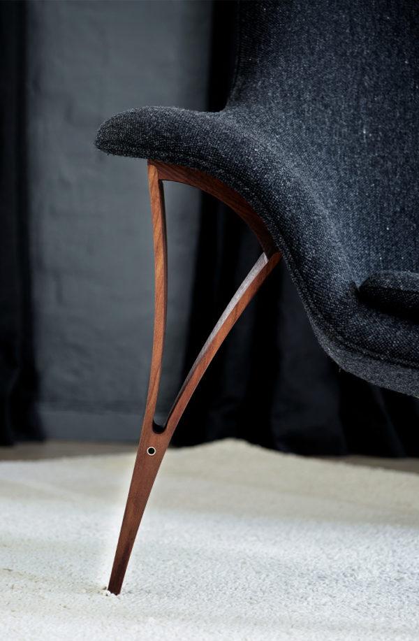 Detaljer af lænestol i uld